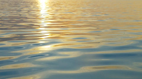 Rippling water with sunset reflection Footage