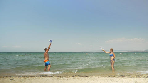 Couple playing ping pong on the beach Footage