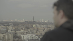 A man looks over the city with many buildings Footage