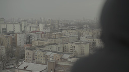 A man looks at a big city during the day Stock Video Footage