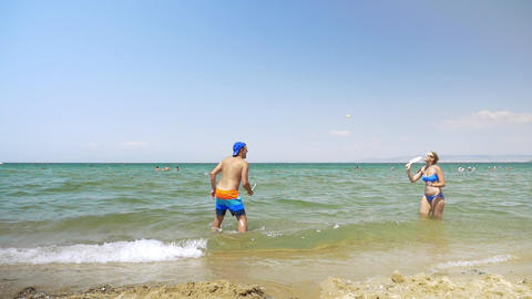 Young couple enjoying ping pong game in the sea Footage