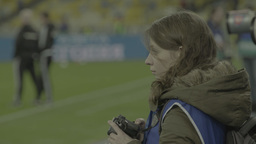Girl sports photographer working at the stadium Footage