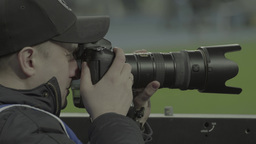 The photographer works at the stadium Footage