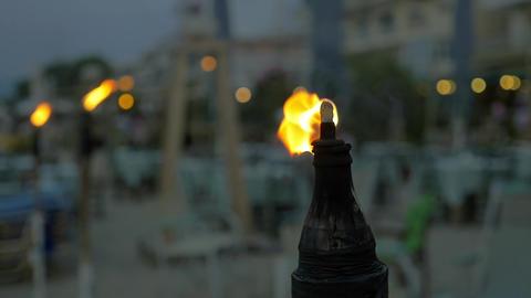 Burning tiki torch at twilight Footage