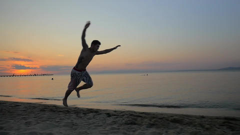 Man showing acrobatics at seaside during sunset Footage