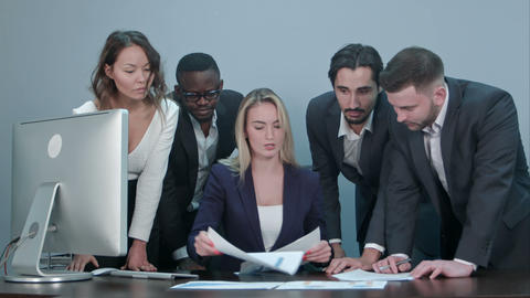 Group of business people busy discussing financial matter during meeting Footage