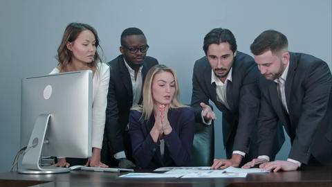 Group of multiethnic diverse young business people in a meeting standing around Footage