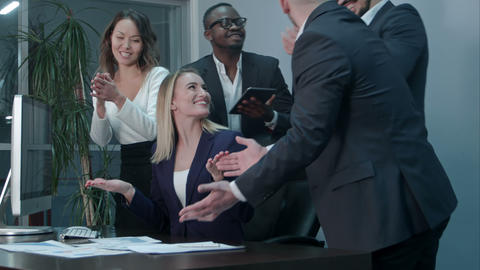 Business people clapping celebrating success at a meeting in the office Footage