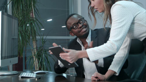 Afro-american boss satisfied with the job of his asian colleague Footage