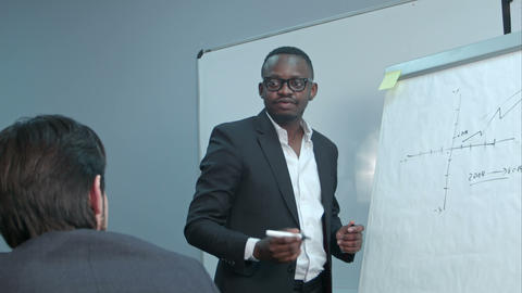 Afro-american businessman making presentation of a business plan on the Footage