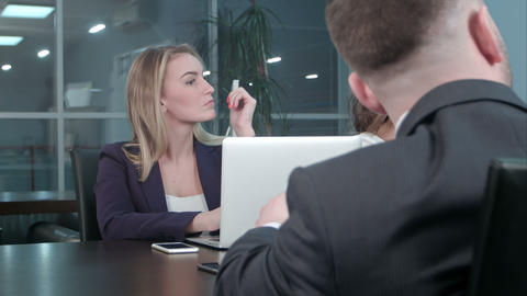Young blond businesswoman working communicate with colleagues at conference in Footage
