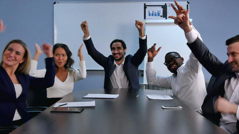 Business team success achievement, people raising arms and smiling Footage