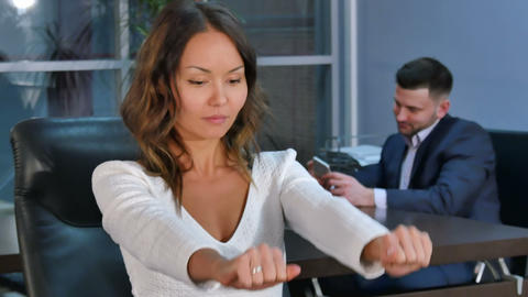 Young asian business woman relax after work, doing exercises for hands and Footage