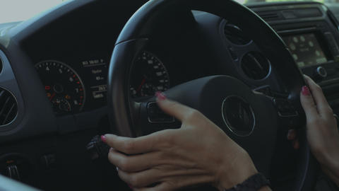 Female hand pushing buttons on steering wheel Footage
