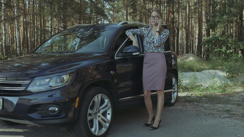Businesswoman with broken car calling for assistance Footage