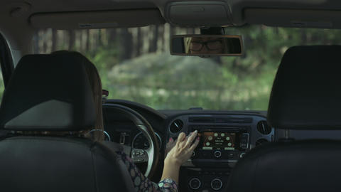 Woman using electronic dashboard in the car Footage
