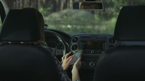 Female driver using smart phone in the car Footage