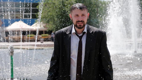 A man, who stands in a fountain, cries bitterly Live Action