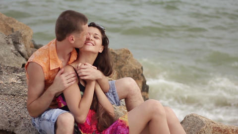 young couple in love embraces on the beach Live Action