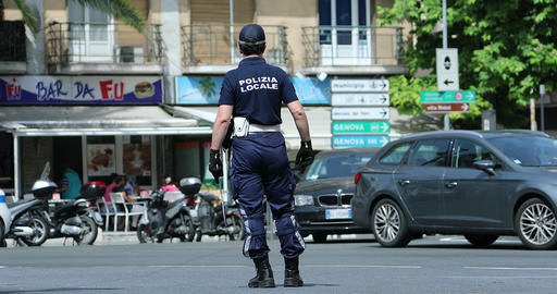 Italian Policeman in Uniform Controlling Road Traffic in The City Center of San Footage