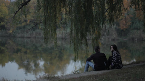 a date on the bank of a pond under a willow Live Action