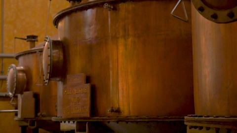 TEQUILA, MEXICO - CIRCA FEB 2017 - Large copper distillery tanks used for making Live Action