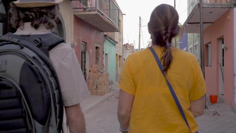 TEQUILA, MEXICO - CIRCA FEB 2017 - Man and woman tourists walking down a GIF