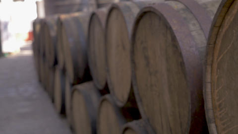 Close up of old oak barrels stacked outside a distillery or winery Live Action