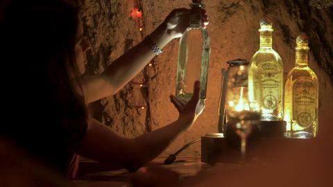 TEQUILA, MEXICO - CIRCA FEB 2017 - Mexican tour guide describing a bottle of Archivo