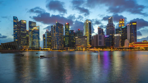 Timelapse of Singapore city skyline and view of Marina Bay day to night time Footage