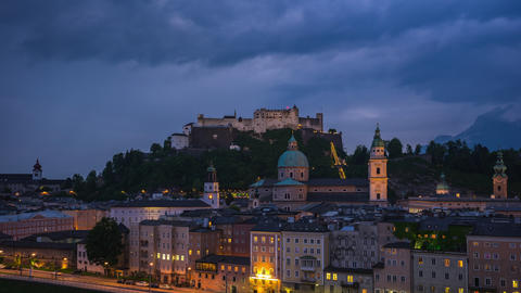 Time Lapse of Salzburg city skyline at night in Salzburg, Austria timelapse 4K Footage