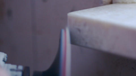 worker grinds a marble window sill Footage