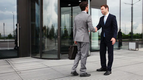 Business people shaking hands ビデオ