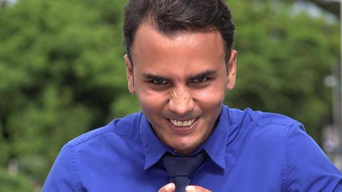 C0268 evil young hispanic business man Footage