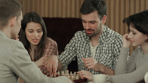 Friends spending time playing chess Footage