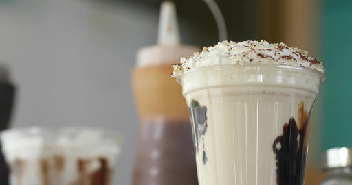 Delicious milkshake on table Live Action