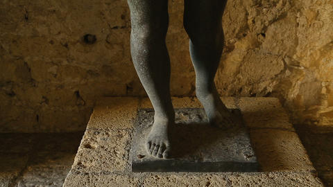 View of bronze statue of Desperate Woman standing inside Egg Castle in Naples Footage