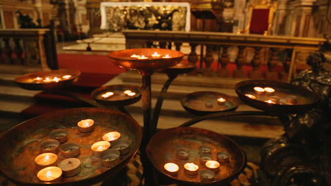 Rounded burning candles standing in front of altar of St. Januarius, faith Footage