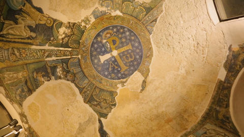 Old mural paintings with image of angel and lion, symbol of baptistery, church Live Action