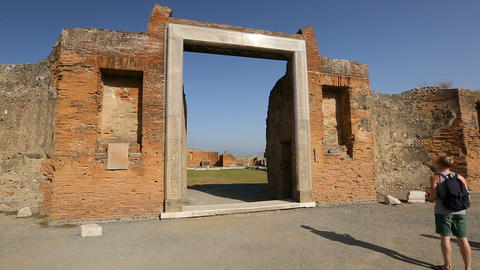Big square entrance in ruined wall in Pompeii, Latin inscription on entablature Footage