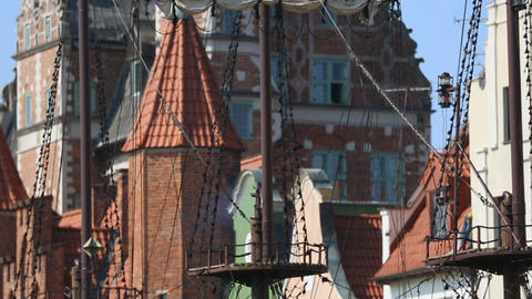 Panoramic view of ancient beautiful warship and brick building Gdansk, history Live Action