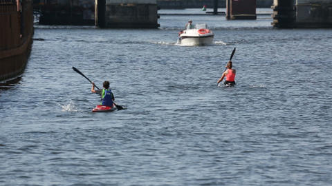 People kayaking on river, recreational boating activity, sport and hobby Live Action