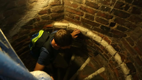 Emotional male tourist climbing the stairs in ancient tower at Gdansk, tourism Footage