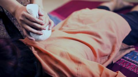 Traditional Thai massage or Thai yoga massage Live Action