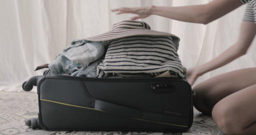 Girl packing and closes her suitcase Footage