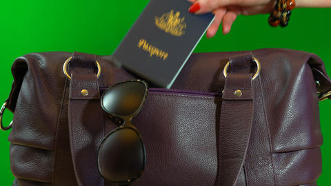4k Travel concept with woman placing passport into carry bag and carrying it Live Action