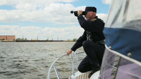 fishery protection employee looks for violators using binoculars Footage