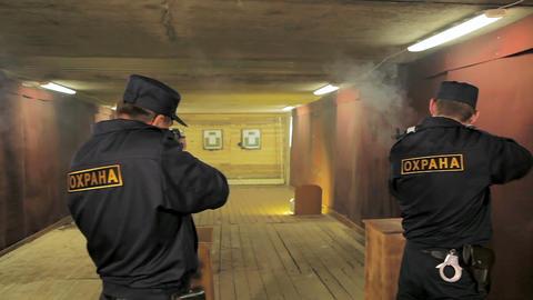 security men train gun shooting in rifle range Footage