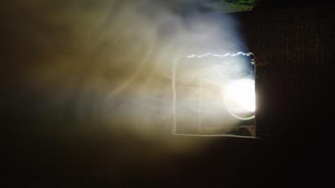 smoke cloud hides cinema projector in darkness Footage