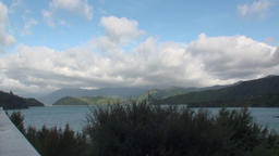 Seascape on background of horizon, clouds in sky and mountains in New Zealand Footage